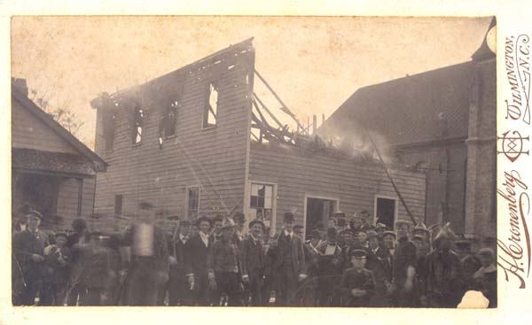 The destruction of the Daily Record building by Waddell's Army during the Wilmington Riot of 1898.