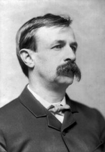 Photo of Edward Bellamy looking to the right wiht large handlebar mustache