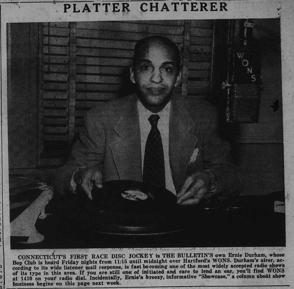 "A photo of Ernie Durham, Connecticut's first ""Race"" Disc Jockey at his turntable."