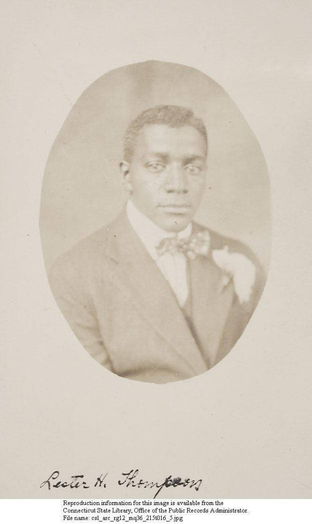 Sepia oval-shaped photograph of Lester H. Thompson on paper with his signature appended at the bottom of the backing sheet.