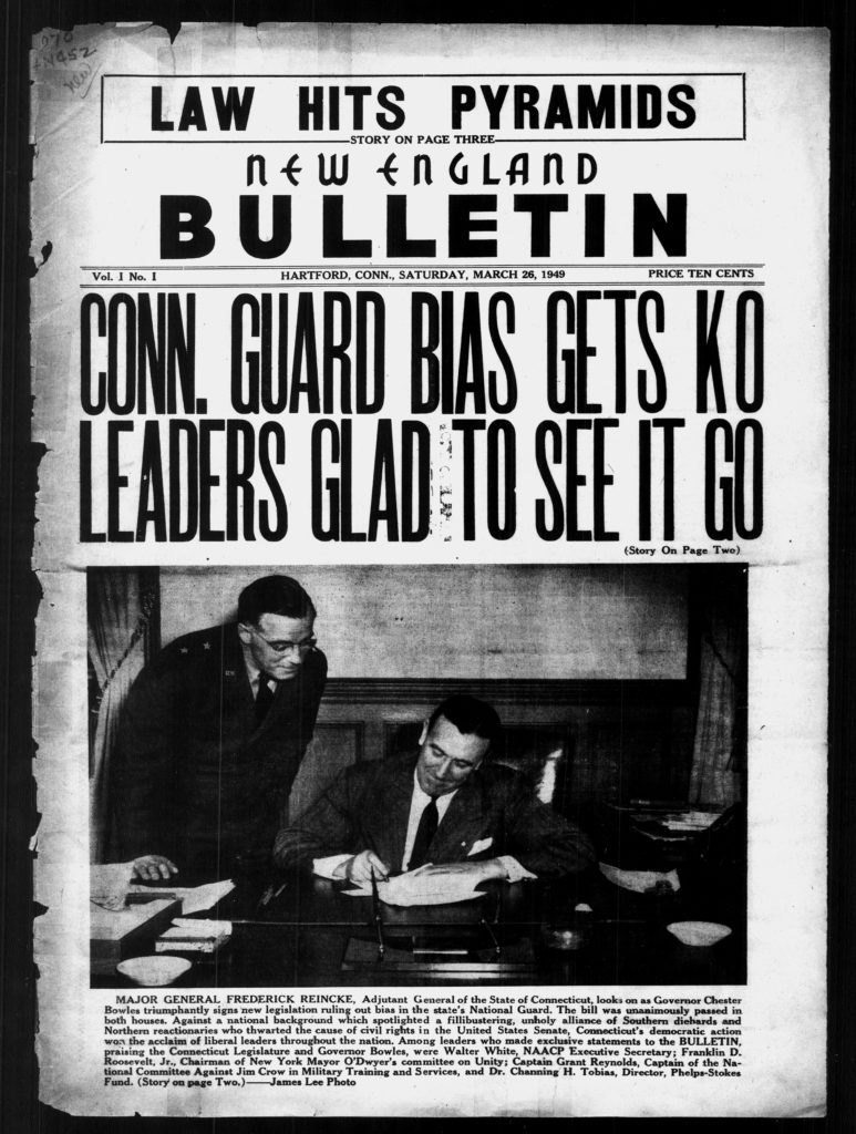 Front page with photo of Governor Chester Bowles signing legislation ruling out bias in the National guard, Major General Reincke is looking over his shoulder.